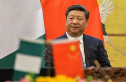 China president in rare visit to virus patients, medics
