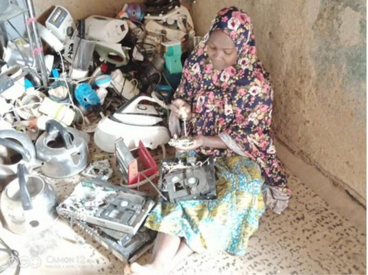 Wow! Meet Hafsat, The Mother Of 7 Children Who Became An Electrician Without Training In Jos